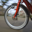 Spinning bicycle wheel — Stock Photo