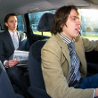 Taxi driver and passenger — Stock Photo