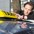 Placing the Taxi sign — Stockfoto