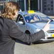 Hauling a taxi — Stock Photo