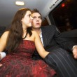 Young lovers in the backseat — Stock Photo #2111286