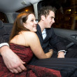 Young lovers in the backseat — Stock Photo