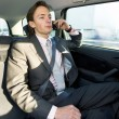 Backseat business call — Stock Photo #2111344