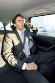 Backseat business call — Stock Photo