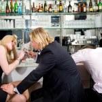 Flirting at a bar — Stock Photo