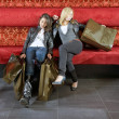 Two women resting after shopping — Stock Photo #2141589