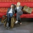 Stock Photo: Two women resting after shopping