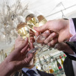 Toasting on new years eve - Stock Photo