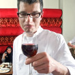 Wine waiter savouring wine — Stock Photo