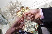 Toasting on new years eve — Stock Photo