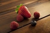Berries on an old wood background — Stock Photo