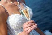 The bride with a glass of champagne — Stock Photo