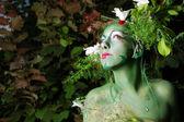 Green environmental face painting — Stock Photo