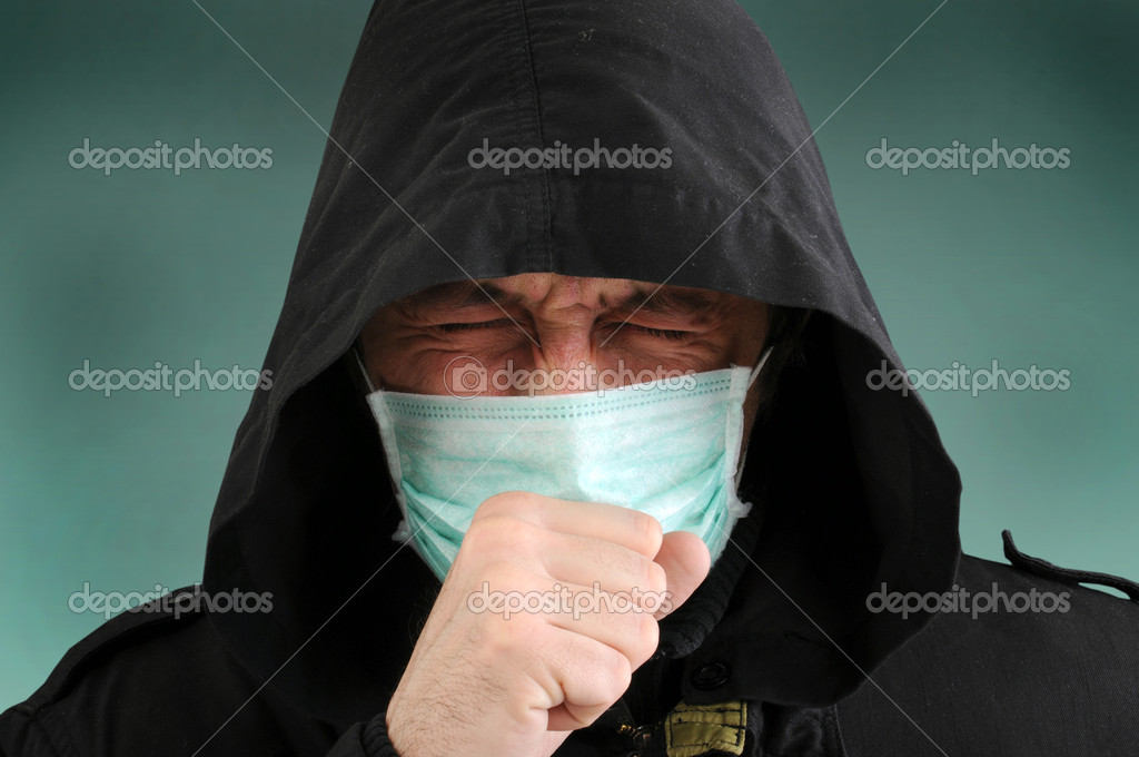 A man with a medical mask covering face, coughing. — Stock Photo #2085080
