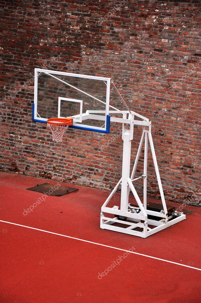 Basketball hoop and an empty outdoor court.  Stock Photo #2109233