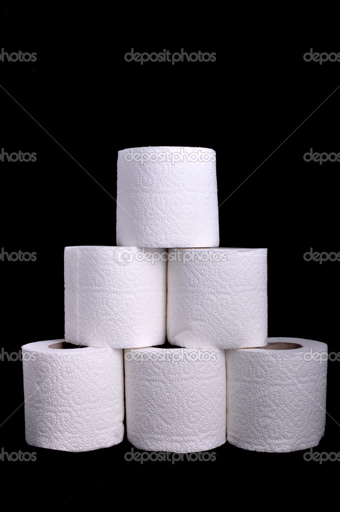 Toilet paper rolls forming a pyramid, isolated on a black background  Stock Photo #2110679