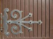 Hinge on wooden door — Stock Photo