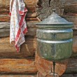 Stock Photo: Towels and wash basin on wooden wall