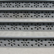 Cast iron steps with floral ornaments — Stock Photo