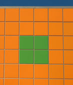 Wall, faced with orange and green tiles — Stock Photo