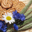 Cookies and a bunch of cornflowers — Stock Photo