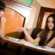 Boy and girl at table together - Stock Photo