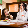 Two beautiful girls at table — Stock Photo