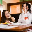 Two beautiful girls at table — Stock Photo #2077503