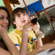 Girl and boy drink wine — Stock Photo