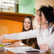Two girls at table — Stock Photo