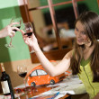 Stock Photo: Two girls drink wine