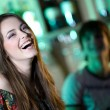 Long-haired girl in bar — Stock Photo