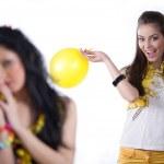 Girl with yellow balloon and nice girl — Stock Photo