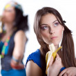 Two girlfriends with banana — Stock Photo #2167458