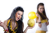 Girl with balloon and girl with fruit — Stock Photo