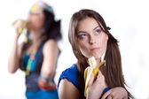 Two girlfriends with banana — Stock Photo