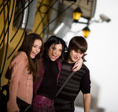 Two cheerful girls with boy — Foto de Stock