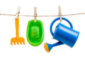 Plastic toys hanged with clothespins — Stock Photo