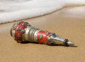 Ancient bottle cast ashore — Stock Photo