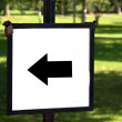 Left arrow on an outdoor sign — Stock Photo
