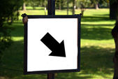 Diagonal down and right Arrow on a sign — Stock Photo