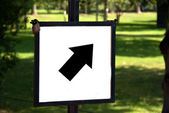 Diagonal up and right Arrow on a sign — Stock Photo