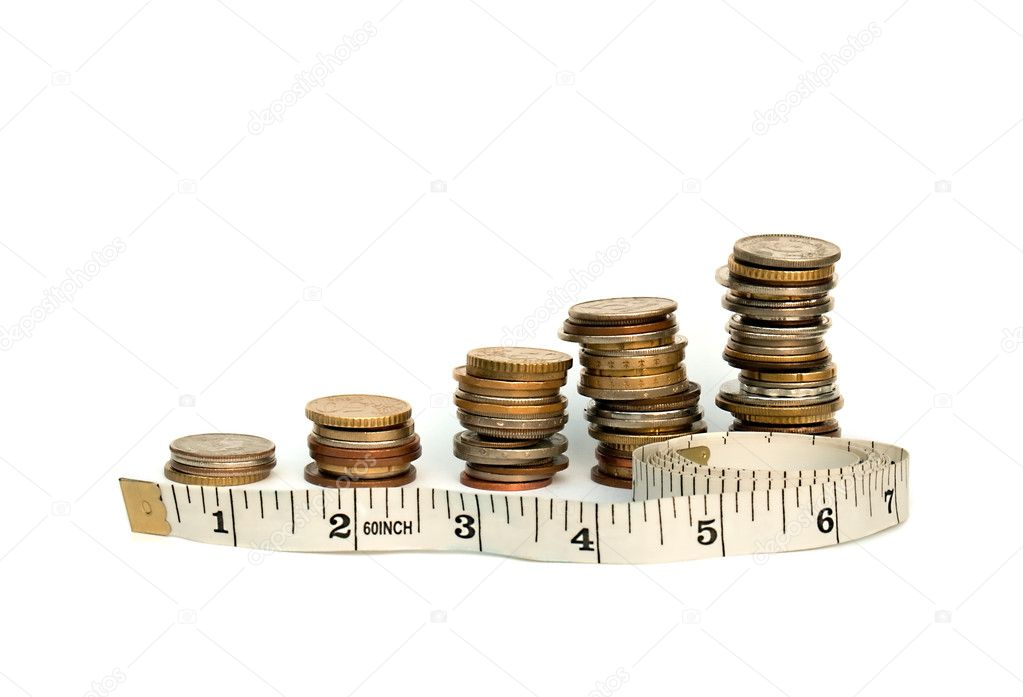 A tape measure and a stack of coins, depicting the counting/measuring of money. This file shows measuring business growth.  Stock Photo #2177193