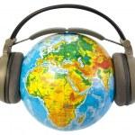Earphones on world globe isolated — Stock Photo #2115167