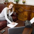 Stock Photo: Smiling businesswoman at work