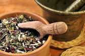 Mortar with bowl and herbs — Stock Photo