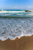 Foamy water on beach — Stock Photo