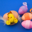 Stock Photo: Egg with easter chicks and colorful eggs