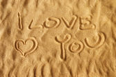 I love you written on sand — Stock Photo