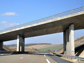 Bridge above a highway — Stock Photo